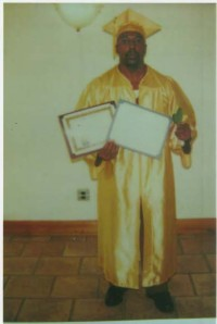 John holding his diploma/certificate from Penn State College of Horticulture and Landscape Design, 2007.